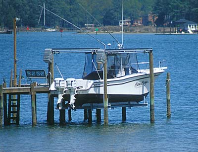 Fishing Boat on lift at end of pier, ready to go fishing in the Chesapeake Bay Photo